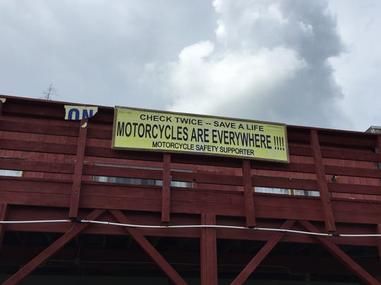 A sign for motorcycle safety hangs outside American Legion Post 1305 on Lower Stella Ireland Road in the Town of Union.