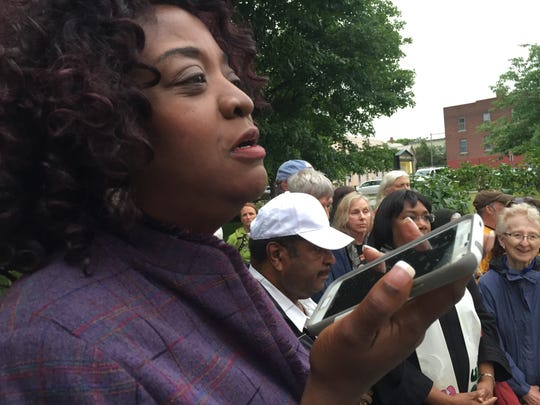 Mary Brown Guillory, president of Champlain Region NAACP, speaks Saturday night at a downtown vigil to mourn recent victims of shooting violence.