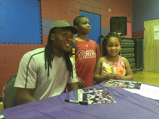 Former Daniel High and Clemson University football star DeAndre Hopkins mugs for a photo with a couple of young fans Saturday.
