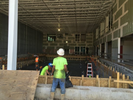Workers make progress on the YMCA Aquatic Center, which will feature two pools.