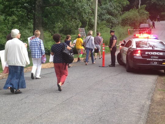 People are walking to Gov. Andrew Cuomo's house to