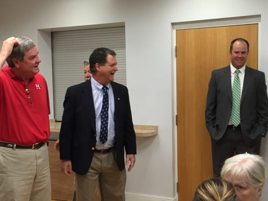 Brian Lewallyn (far right) shares laugh with Pensacola