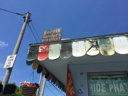 Signs supporting Bernie Sanders for president cropped up all around Burlington, including this sign at Ridin' High longboard skate shop in Burlington, seen on  Tuesday, July 12, 2016. The owner says he may write in Sanders' name on the ballot in November.