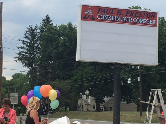 A sign dedicates the Conklin Fair Complex to the event's CEO, Paul Preston, husband of county Executive Debbie Preston, who passed away last year.