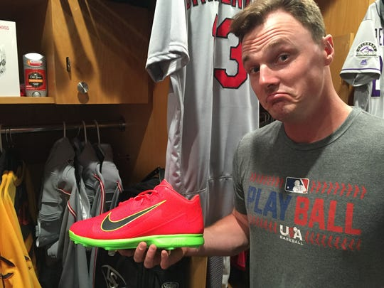 Jay Bruce holds his All-Star Game Nike.