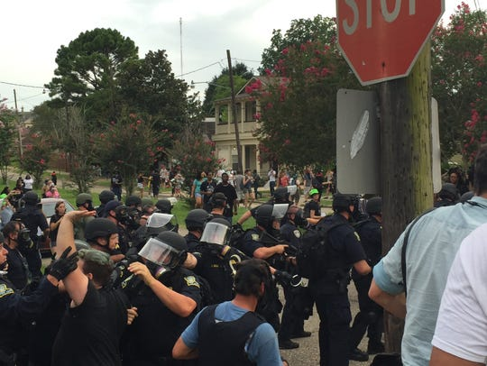 Police in riot gear moved in on protesters several