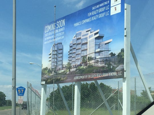 A billboard announces a redevelopment project for luxury condos at Long Branch's beachfront.