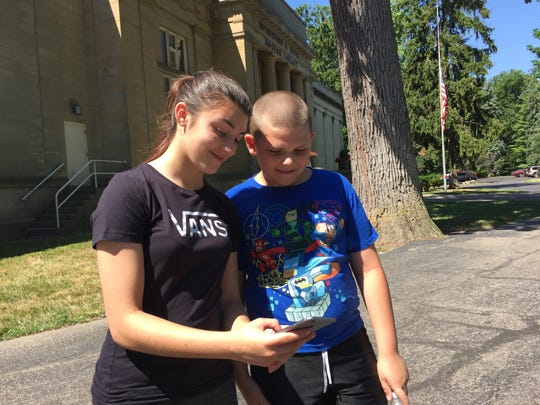 Jenny Guerrero, 14, and brother Ayden Ross, 9, search for Pokémon characters at the Rutherford B. Hayes Presidential Library and Museum.