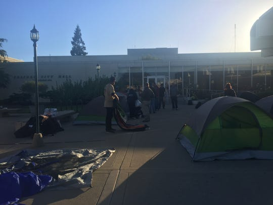 Homeless pitch tents in front of Salinas City Hall on July 12