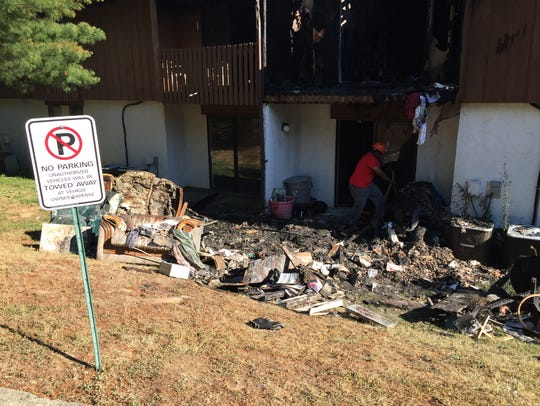 Debris from Tuesday's fire at Chelsea Square Apartments