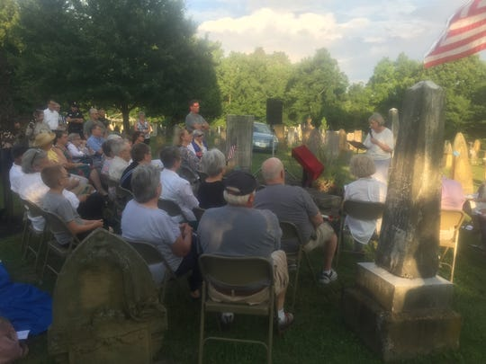Lyn Boone, historian and Union Cemetery Board member, makes opening remarks during the July 12 ceremony.