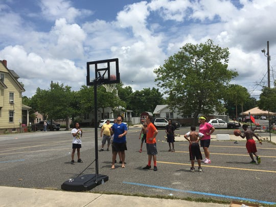 Hot or not, a basketball hoop got steady use on Wednesday