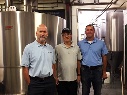 From left, Todd Bemis, Kwang Casey and Billy Bemis. The group has partnered to redevelop the retail center where Oaken Barrel Brewing Company resides.