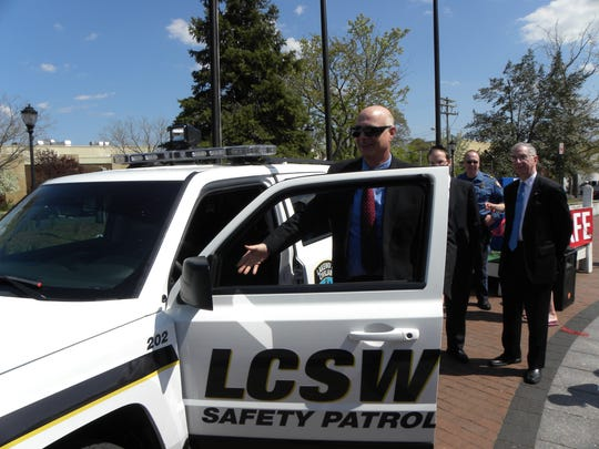 Lakewood Police Chief Robert Lawson inspects a new vehicle used by the Lakewood Civilian Safety Watch program.