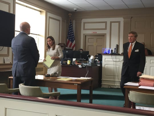 Former Madison police officer Chad Rybka, with his attorneys, appears for sentencing in state Superior Court , Morristown, on Friday.