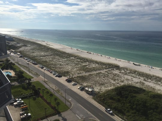 Beach goers arrive at Pensacola Beach early Friday