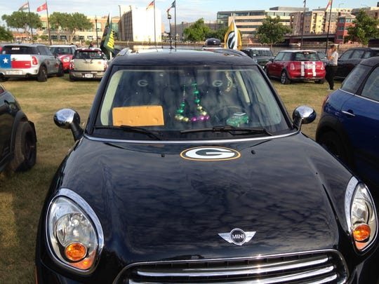 Green Bay Packer-themed Mini Cooper is among the nearly 1,400 that stopped in Titletown during the tour.