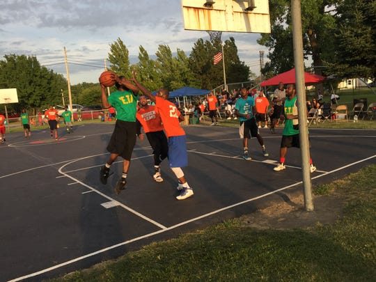 The Hidden Gems of Marion and Columbus (orange) beat Mansfield One (green) 66-44 in Sunday's championship game of the 32nd annual Mayes Community Temple Outdoor Hoops Classic at Martin Luther King Jr. Park in Marion.
