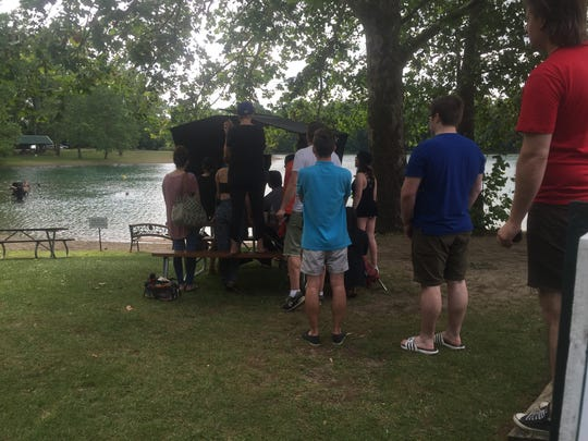 Crew members gather to watch filming of a critical scene underway in Lake Hudson.