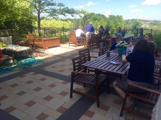 """Delivra let its employees decorate the patio space in a """"Delivra Design on a Dime"""" competition."""