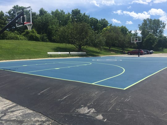 NextGear Capital built a standard size basketball court for its employees to use.  The company's logo is in the middle of the court.