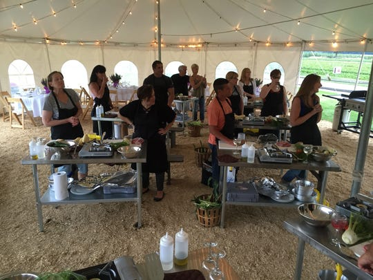 Participants listen to instructions at Donaldson's Farm Harvest, Cook and Dine pilot event on July 13, 2016.