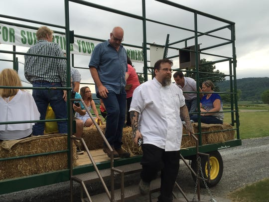Participants return from a hayride out to the fields with Chef Eric LeVine to kick off the Harvest, Cook and Dine pilot event hosted by Donaldson's Farm in Hackettstown on July 13, 2016.
