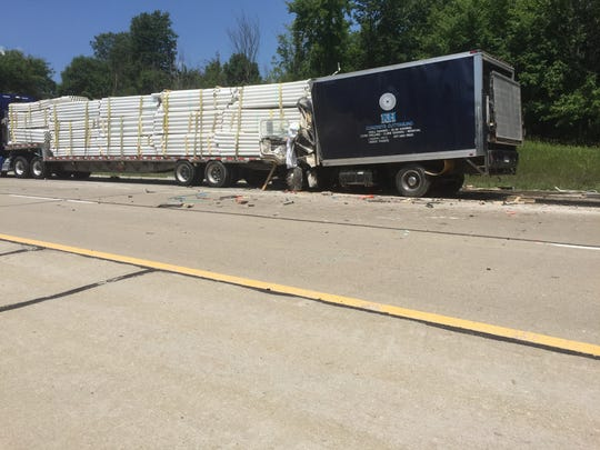Michigan State Police said a 39-year-old Owosso man died Wednesday when his GMC box truck rear-ended the trailer of a Peterbilt semi trailer that had slowed for traffic on Interstate 96 in Howell Township.