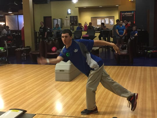 Marion's Brandon Keirns delivers the ball during a league session last week at bluefusion entertainment. Keirns, with the help of his mother Lisa Keirns, is bringing the PBA Greater Marion Central Open to his hometown July 29 to 31.