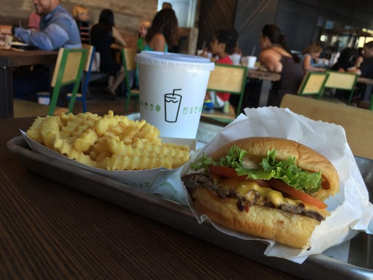 Burger, crinkle cut fries and a chocolate shake at Shake Shack in Yonkers.