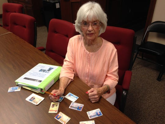 Hilda Little is the coordinator of the Community Anti-Drug Coalition. She is pictured with a number of fake ID's.