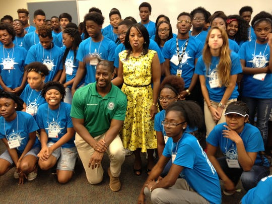 Mayor Andrew Gillum and Kimberly Moore, VP Workforce Development at TCC, pose with some members of the Tallahassee Future Leaders Academy during a student visit Thursday at TCC..