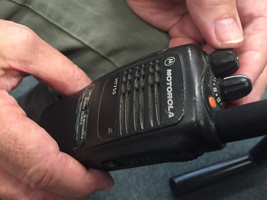 Chief Doug Brent shows off a portable radio, HT750 from Motorola, which was purchased in 2003, on Wednesday, July 20.