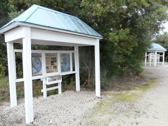 Information kiosks greet visitors at the starting point to two hiking trails at the Florida Panther National Wildlife Refuge.