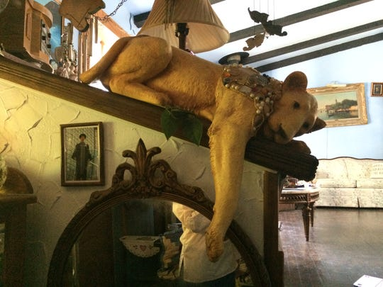 Henrietta Raymond's jeweled lion statue lays near the front entrance of her home.