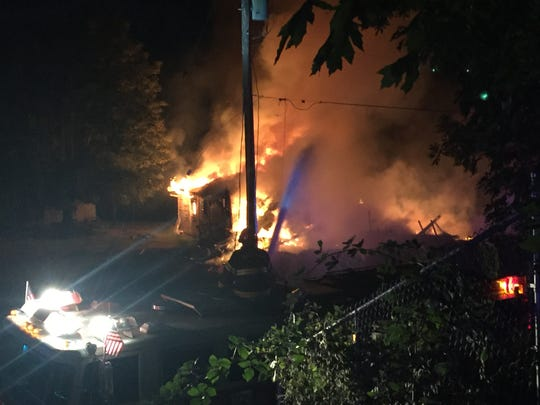 Flames engulf a two-story home in Falls City early