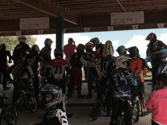 Racers gather behind the starting gates at a recent state competition at Pineview Park in St. Cloud.