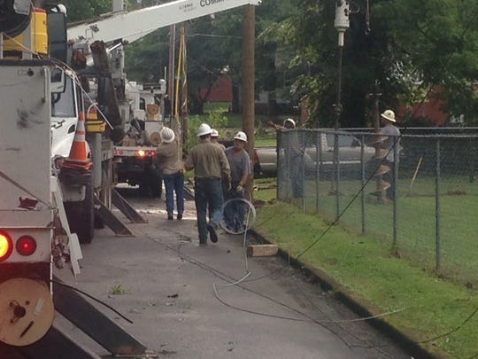 Crews worked along Martha Street in east Jackson on Friday afternoon to restore power to the neighborhood after a Friday afternoon thunderstorm.
