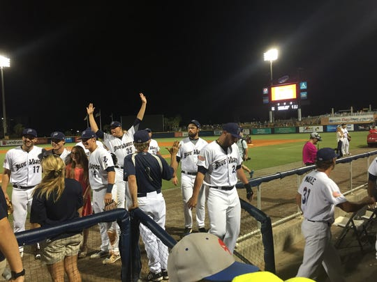 The Blue Wahoos enjoy their 7-3 win Saturday night against the Biloxi Shuckers.