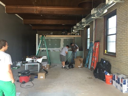 Owner/brewer Keith Owens watches as work continues at his soon-to-open Rochester brewery.