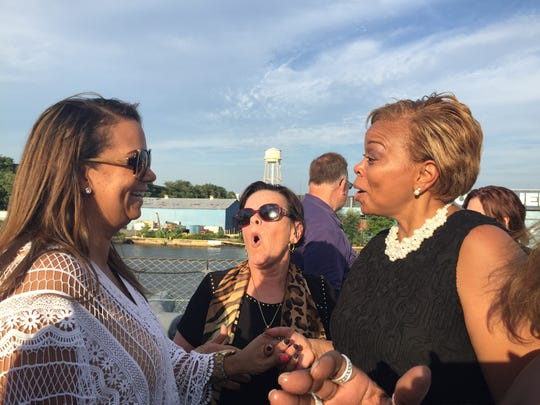 Camden Mayor Dana Redd (right) chats Sunday with Lizette Delgado-Polanco (left) , vice chairwoman of  the New Jersey Democratic Party  at a kick-off reception on the Battleship New Jersey for the Democratic National Convention.