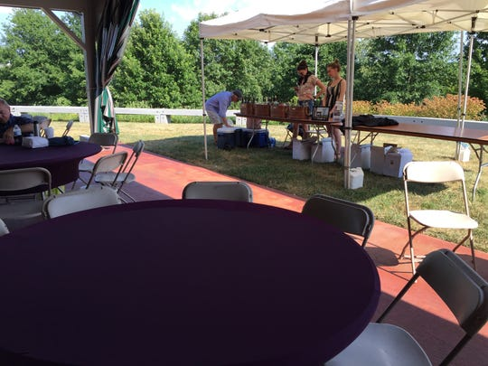 Barren Ridge Vineyards sets up a table at the Frontier Culture Museum on a hot Sunday night for the American Roots concert series.