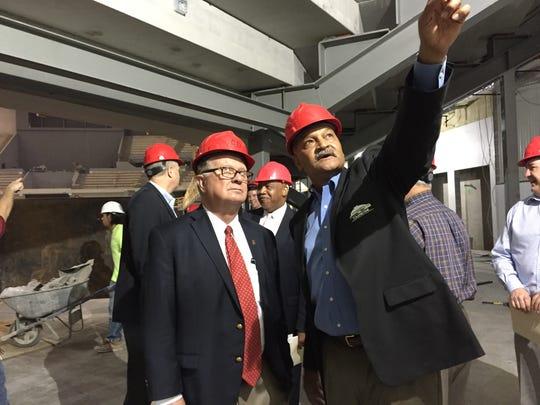 Cajundome Director Greg Davis, right, explains features of the Cajundome renovation project to E. Joseph Savoie, president of the University of Louisiana at Lafayette, July 25, 2016.