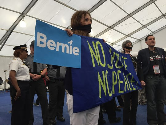 Protesters who support Sen. Bernie Sanders, I-Vt., stormed the media filing center after Hillary Clinton officially became the Democratic Party's nominee for president Tuesday, July 26, 2016, in Philadelphia. Sanders endorsed Clinton and asked his supporters not to protest.