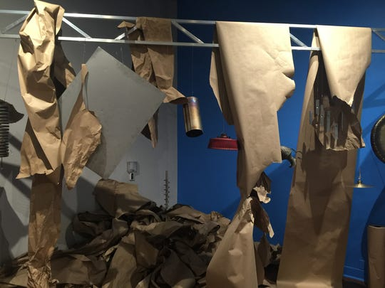 """Visitors to Rauschenberg Gallery are encouraged to grab a mallet and hit the various metal objects hanging from two frameworks. The idea is to perform Philip Corner's """"Metal Meditations"""" by following the """"graphic score"""" on the gallery walls. You can also make music by crumpling paper."""