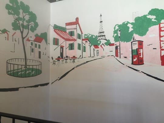 A mural painted by Kris (Guske) Stuart covers a wall in her parent's Port Huron home.