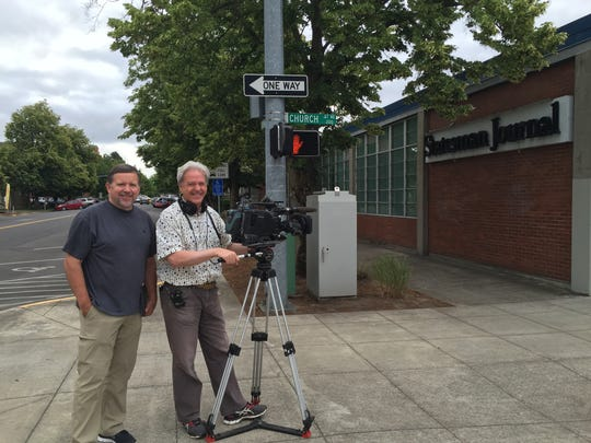 Forrest Burger, left, and Paul Ramsey were sent to Salem on Saturday, July 16, 2016, to interview Statesman Journal columnist Capi Lynn about the Benny story for Inside Edition. The producer and director of photography from the Portland-Vancouver area, also interviewed some of the local people who have found the $100 bills signed by the mystery philanthropist.