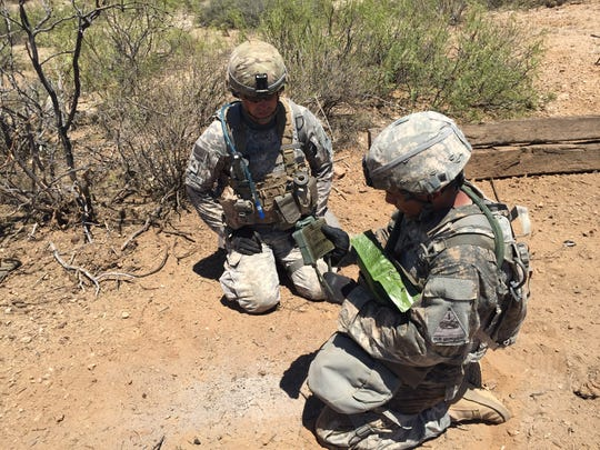 Sgt. Shane Nowaskey and Pvt. Gustavo Miranda set up a Claymore mine during the live-fire portion of Rifle Focus.