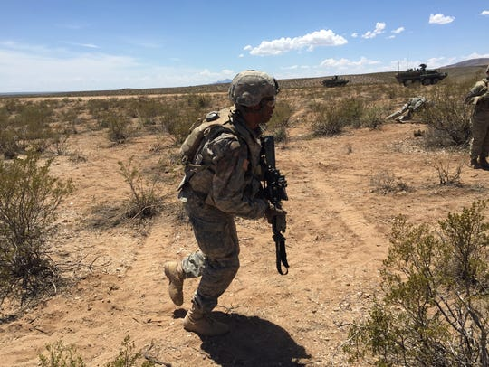 A soldier runs to position during Rifle Focus.