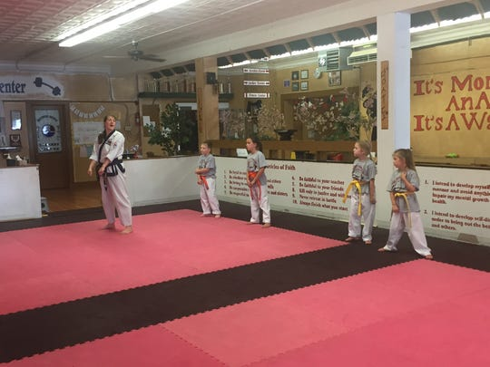 Tri City Karate Academy instructor Cheryl Davis, left,